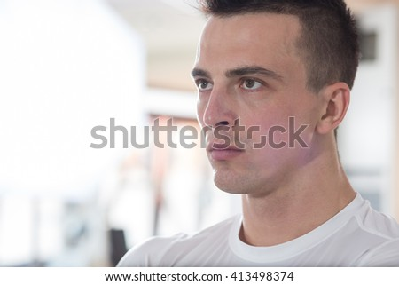 Sporty Man Resting In A Gym. Portrait Of A Young Muscular Sporty Fit Caucasian Man - stock photo