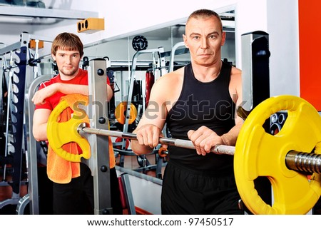 Sporty men in the gym..