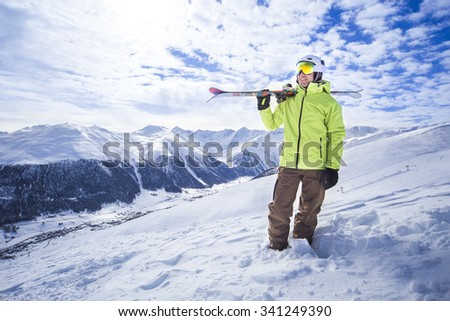 Sporty men with skis in a snow mountain resort - stock photo
