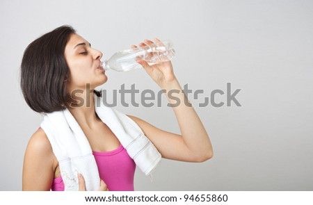sporty muscular girl drinking water