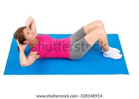 Sporty woman doing sit-ups - stock photo