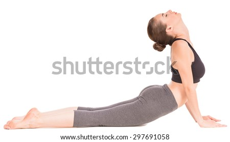 Sporty woman doing yoga exercise  in cat pose. - stock photo