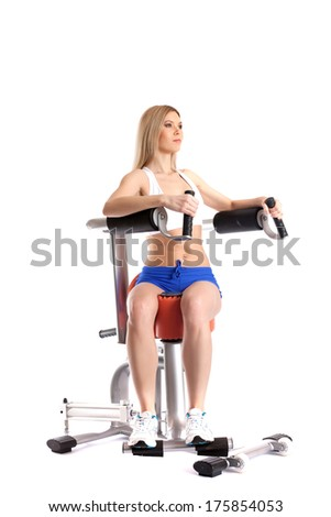 Sporty woman exercising on modern simulator