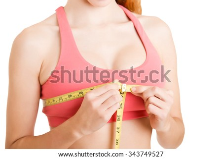 Sporty woman measuring up her chest, isolated in white