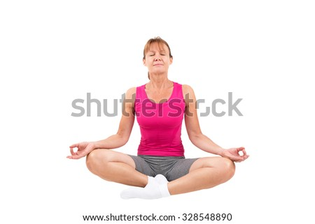 Sporty woman meditating - stock photo