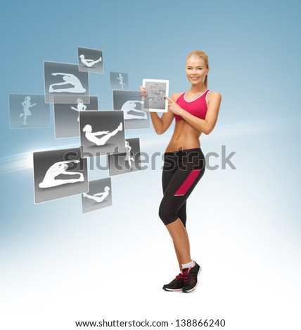 sporty woman pointing at tablet pc and virtual application