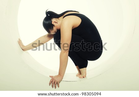 sporty woman posing in a circle - stock photo