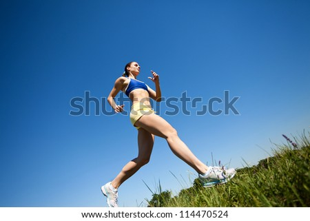 sporty woman running outdoor - stock photo