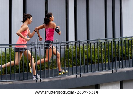 sporty woman running uphill outdoors for morning workout - stock photo