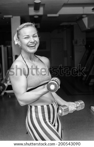 sporty woman training with dumbbells
