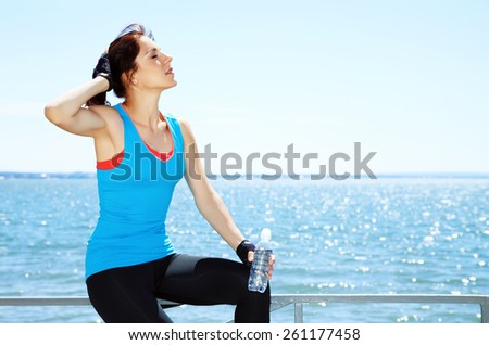 sporty woman with a water bottle in training. outdoor sports. healthy sport lifestyle - stock photo