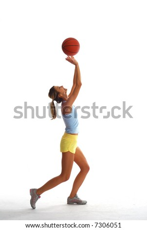 Sporty woman with basket ball