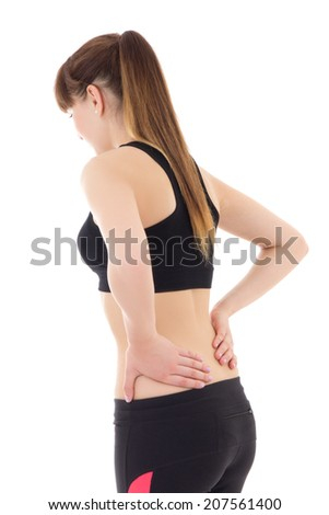sporty woman with pain in her back isolated on white background