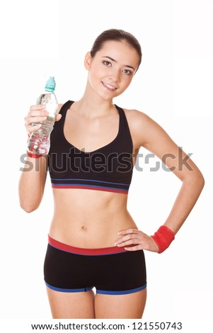 sporty woman with plastic bottle of water after fitness workout