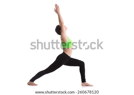 Sporty yoga girl on white background doing lunge exercise, Warrior 1 posture, Virabhadrasana I, back foot on the floor - stock photo