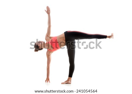 Sporty yoga girl on white background in ardha chandrasana (Half Moon Pose) - stock photo