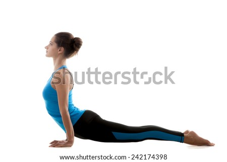 Sporty yoga girl on white background in Urdhva mukha svanasana (Urdhvamukhasvanasana,  Upward Facing Dog Pose) - stock photo