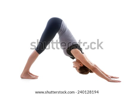 Sporty yoga girl on white background stretching in pose Adho Mukha Svanasana (downward-facing dog Pose, downward dog, down dog) - stock photo
