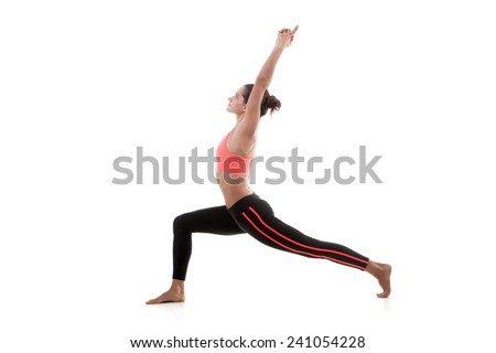 Sporty yoga girl stands on white background in virabhadrasana 1 (Warrior 1 Pose) - stock photo