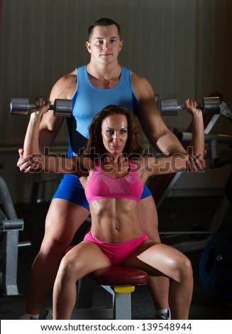 Sporty young Caucasian woman exercising in the gym - stock photo