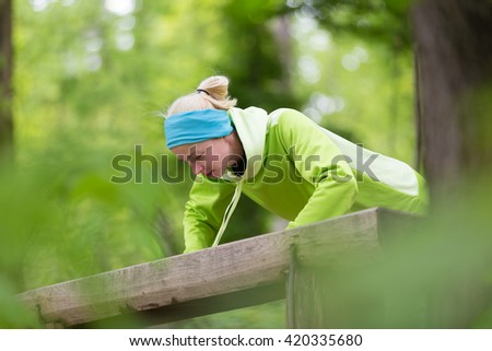Sporty young female working out in forest.  Female runner during outdoor workout in nature. Fitness model outdoors. Weight Loss. Healthy lifestyle.  - stock photo