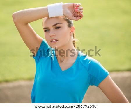 Sporty young woman after training. Wellness and healthcare concept. - stock photo