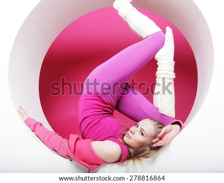sporty young woman posing in pink circle - stock photo
