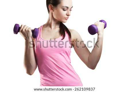 Sporty young woman with dumbbells, isolated on white background