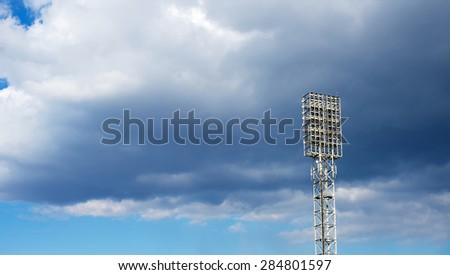 Spot-light tower on the blue sky