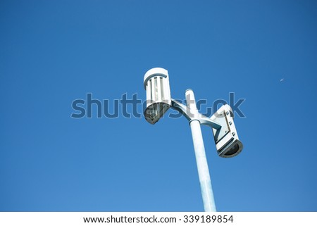 Spot-light tower on the sky - stock photo