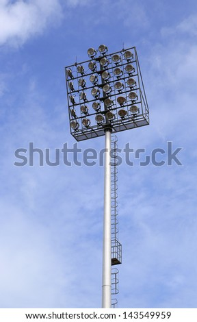 Spot-light tower with blue sky