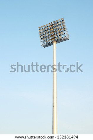 Spot light tower with sky background - stock photo