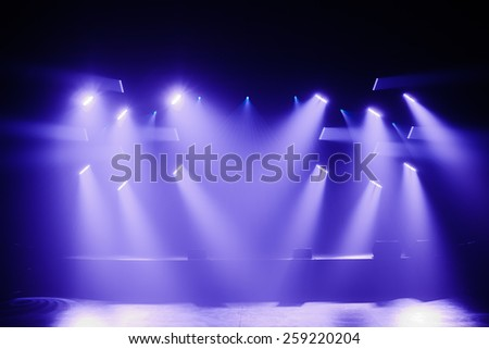 Spot lights on a Empty Stage before a Big Concert - stock photo
