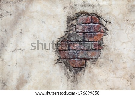 Spot of brick stones on a concrete plastered wall/Brick Wall Spot - stock photo