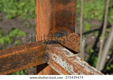 Spot weld. Mounting frame fence from metal sheets. - stock photo