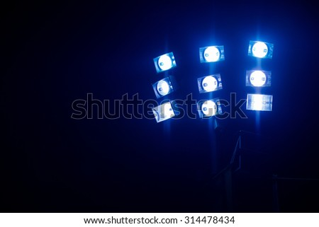 spotlight and lighting equipment, floodlight. lighting at the stadium - stock photo