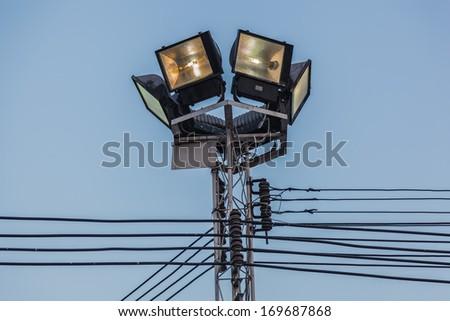 spotlight illuminate the locations on the blue sky - stock photo
