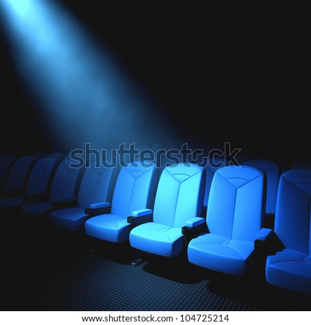 Spotlight on an empty chair. Concept of someone important to arrive. - stock photo