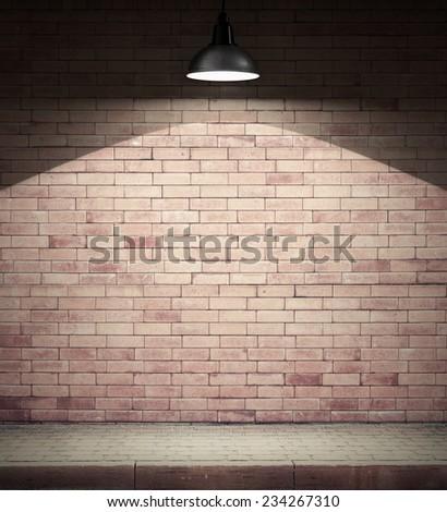 Spotlight on empty brick wall. - stock photo