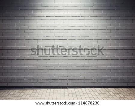 Spotlight on empty street wall. - stock photo