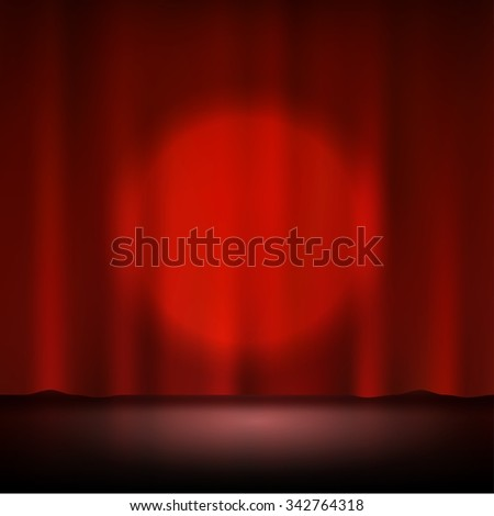 Spotlight on stage red curtain - stock photo