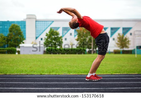 spotrsmen warming up before a run - stock photo