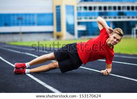spotrsmen warming up before a run. Happy athlete smile - stock photo