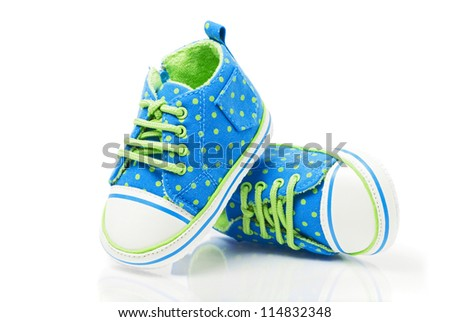 Spotted baby sneakers closeup isolated on white - stock photo