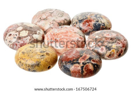 Spotted jasper coin beads, multicolored isolated on white - stock photo