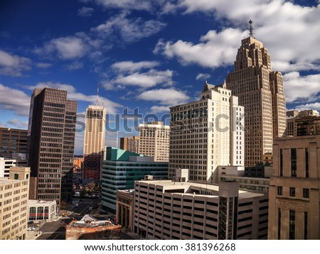 Sprawling building in the downtown core, against the blue sky - stock photo