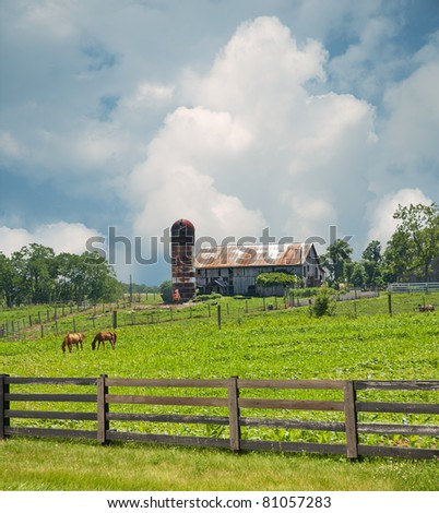 Sprawling pastures surround a horse farm in Kentucky, USA. - stock photo