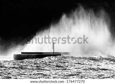 spray and foam after big wave breaking on waterbreak - stock photo