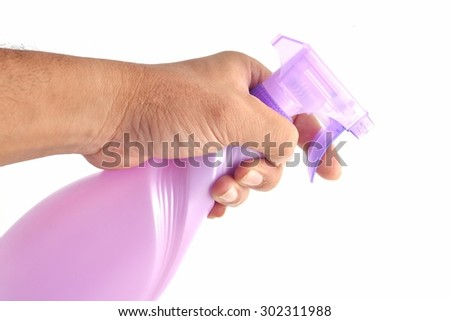 Spray bottle by hand on white background. - stock photo