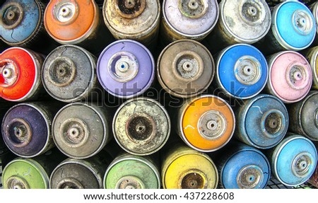 Spray cans photographed from above, you see all the colors usable. - stock photo